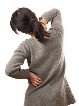 Болит спина отдает в яичники